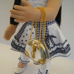 Doll with Silver Fun Bag